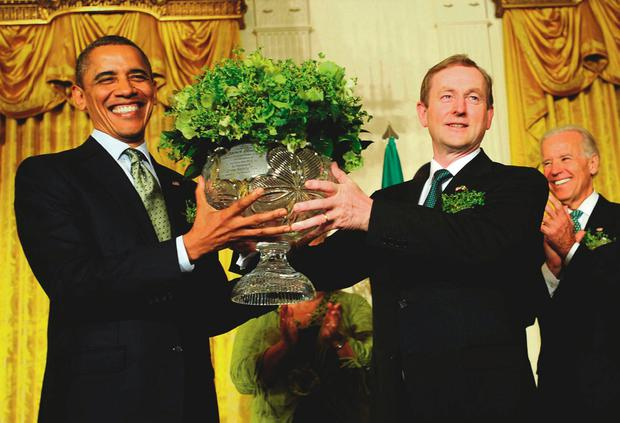 President Barack Obama receives the traditional bowl of shamrock. Donald Trump has invited the Taoiseach to the White House on St Patrick's Day. Photo: Leslie E. Kossoff/LK Photos