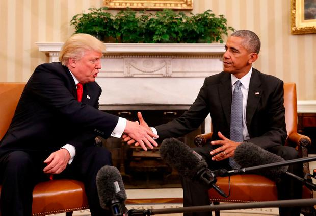 President Barack Obama shakes hands with President-elect Donald Trump in the Oval Office of the White House in Washington yesterday in what was the first meeting of the two, who had traded insults during the election campaign. Photo: Pablo Martinez Monsivais/AP