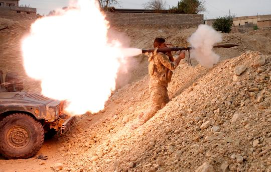 An Iraqi soldier fires a RPG in Karamah, south of Mosul, Iraq. Photo: Reuters