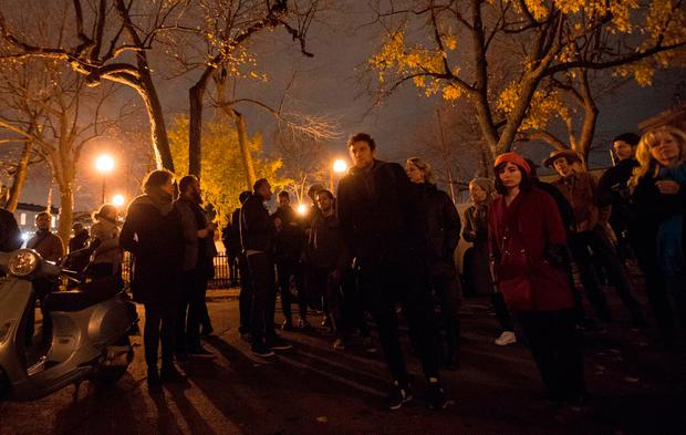 Mourners line up in front of the home of singer and poet Leonard Cohen (Paul Chiasson/The Canadian Press via AP)