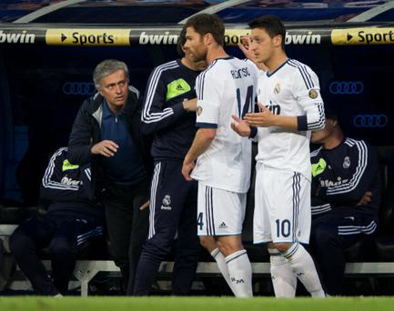 MADRID, SPAIN - MAY 04: Head coach Jose Mourinho (L) of Real Madrid intructs Xabi Alonso (C) and Mesut Ozil (R) while he brings them on as substitutes during the la Liga match between Real Madrid CF and Real Valladolid CF at estadio Santiagio Bernabeu on May 4, 2013 in Madrid, Spain. (Photo by Jasper Juinen/Getty Images)