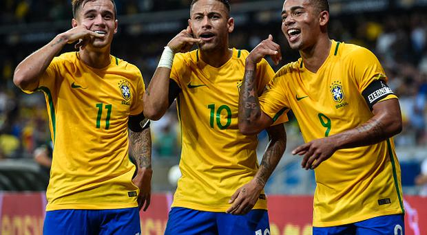 BELO HORIZONTE, BRAZIL - NOVEMBER 10: Philippe Coutinho #11, Neymar #10 and Gabriel Jesus #9 of Brazil celebrates a scored goal against Argentina during a match between Brazil and Argentina as part 2018 FIFA World Cup Russia Qualifier at Mineirao stadium on November 10, 2016 in Belo Horizonte, Brazil. (Photo by Pedro Vilela/Getty Images)