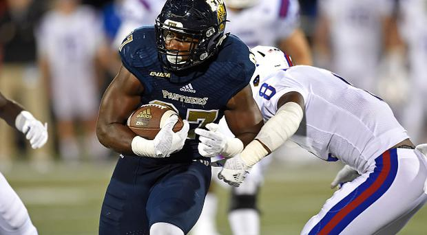 22 October 2016: FIU tight end Jonnu Smith (87) attempts to evade Louisiana Tech defensive back DaMarion King (8) after a reception in the third quarter as the Louisiana Tech Bulldogs defeated the FIU Golden Panthers, 44-24, at FIU Stadium in Miami, Florida. (Photo by Samuel Lewis/Icon Sportswire via Getty Images)