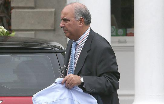 Dr Salah Abdel-Aziz Ahmed, a consultant obstetrician leaves a fitness to practice enquiry by the medical council at Finnstown House in Lucan. Picture credit: Damien Eagers