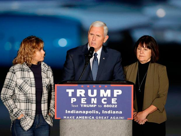 Vice President-elect Mike Pence speaks as he wife, Karen, and daughter, Charlotte, stand next to him during a public rally Thursday, Nov. 10, 2016, in Indianapolis. (AP Photo/Darron Cummings)