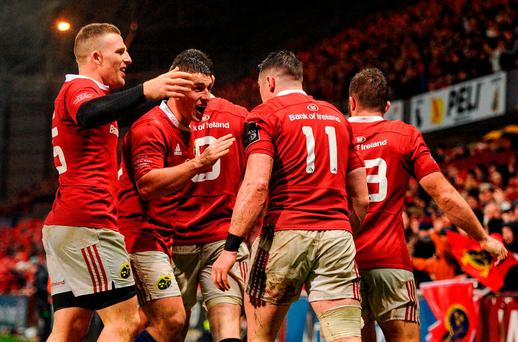 Ronan O'Mahony of Munster celebrates with team-mates Andrew Conway and Ian Keatley after scoring his side's fourth try during the match between Munster and the New Zealand Maori All Blacks at Thomond Park in Limerick. Photo by Diarmuid Greene/Sportsfile