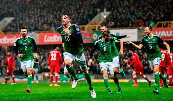 Kyle Lafferty of Northern Ireland celebrates after scoring his side's first goal during the FIFA World Cup Group C Qualifier match between Northern Ireland and Azerbaijan at Windsor Park in Belfast. Photo by Ramsey Cardy/Sportsfile