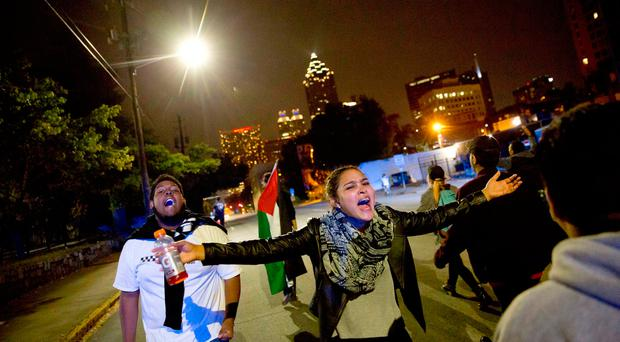 Protesters march in the street to demonstrate against the election of President-elect Donald Trump in Atlanta, Friday. (AP Photo/David Goldman)