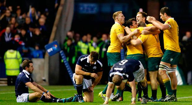 Britain Rugby Union - Scotland v Australia - Murrayfield, Edinburgh, Scotland - 12/11/16 AustraliaÄôs Nick Phipps and Dane Haylett-Petty celebrate at the final whistle with team mates Reuters / Russell Cheyne Livepic EDITORIAL USE ONLY.