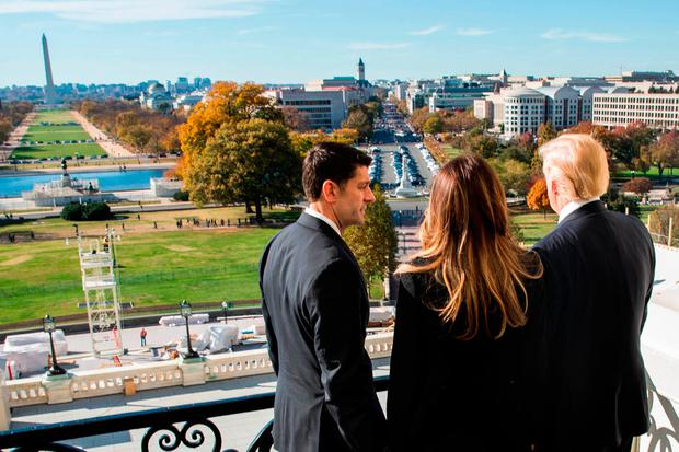 All this will be yours: House Speaker Paul Ryan shows President-elect Trump and his wife Melania the view from the Speaker's Balcony at the US Capitol last week Photo: Zach Gibson/Getty Images