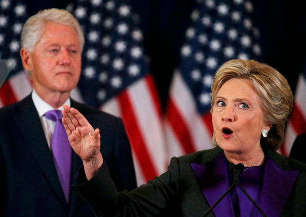Hillary Clinton, accompanied by husband Bill Photo: REUTERS/Carlos Barria