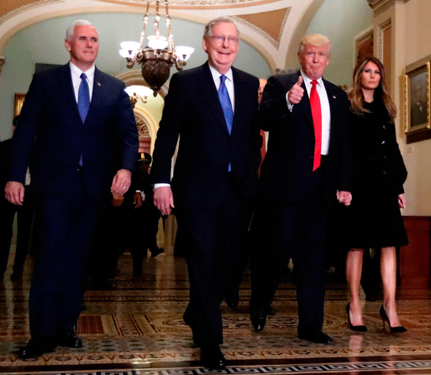 Republicans on a roll: Vice President-elect Mike Pence, senate majority leader Mitch McConnell, President-elect Donald Trump, and Trump's wife Melania as they walked to a meeting on Capitol Hill in Washington last Thursday Photo: Alex Brandon/AP
