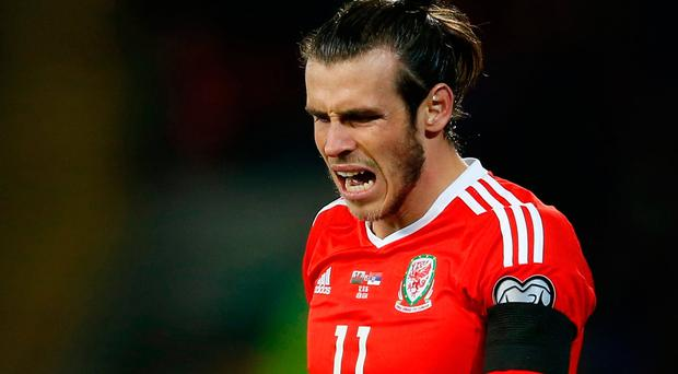 Britain Soccer Football - Wales v Serbia - 2018 World Cup Qualifying European Zone - Group D - Cardiff City Stadium, Cardiff, Wales - 12/11/16 Wales' Gareth Bale looks dejected Action Images via Reuters / Matthew Childs Livepic EDITORIAL USE ONLY.