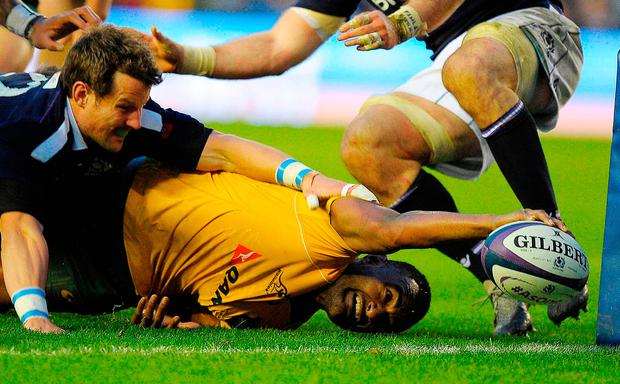 Australia's centre Tevita Kuridrani reaches out to score their final try. Photo: Getty