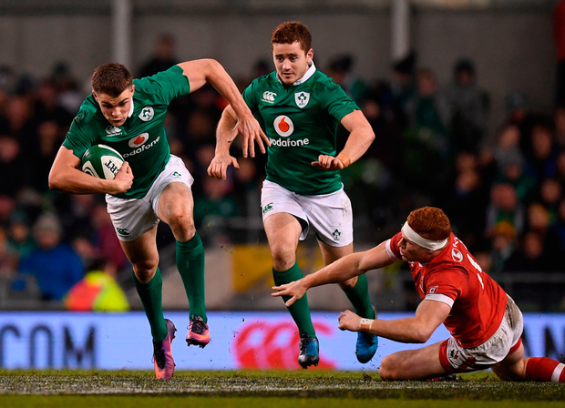 Garry Ringrose makes a break during the Autumn International match against Canada at the Aviva Stadium. Photo: Ramsey Cardy/Sportsfile