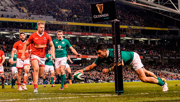 Ireland full-back Tiernan O'Halloran goes over in the corner to score a second-half try against Canada. Photo: Ramsey Cardy/Sportsfile