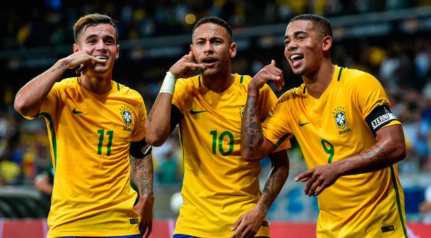 Philippe Coutinho (left) celebrates with Neymar (centre and Gabriel Jesus after scoring against Argentina on Thursday. Photo: Getty
