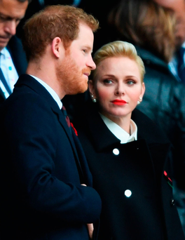 Singled out: Prince Harry was seen with Charlene, Princess of Monaco, in the stands during the match at Twickenham, London, and not his new girlfriend, Meghan. Photo: Shaun Botterill/Getty Images