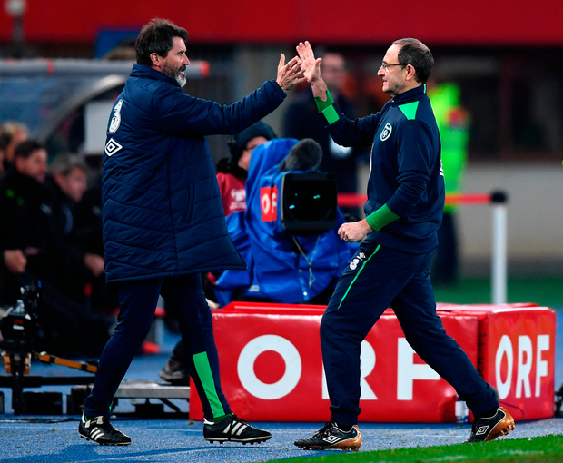 Republic of Ireland manager Martin O'Neill celebrates with assistant manager Roy Keane after final the whistle. Photo: Sportsfile