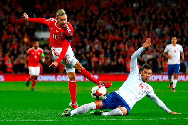 Luka Milivojevic of Serbia blocks the attempt on goal of Aaron Ramsey of Wales. Photo: Getty