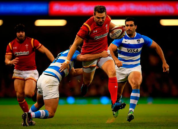Wales' Dan Biggar is tackled by Ramiro Moyano of Argentina. Photo: Getty