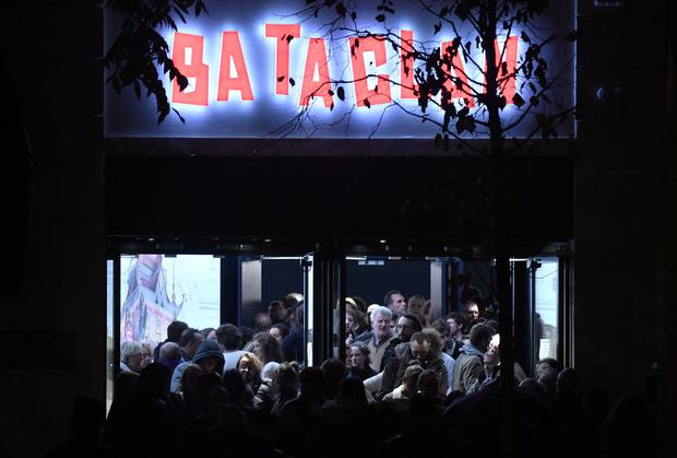 People leave the Bataclan concert hall in Paris on November 12, 2016, after the reopening concert by British musician Sting to mark the first anniversary of the November 13 Paris attacks.
