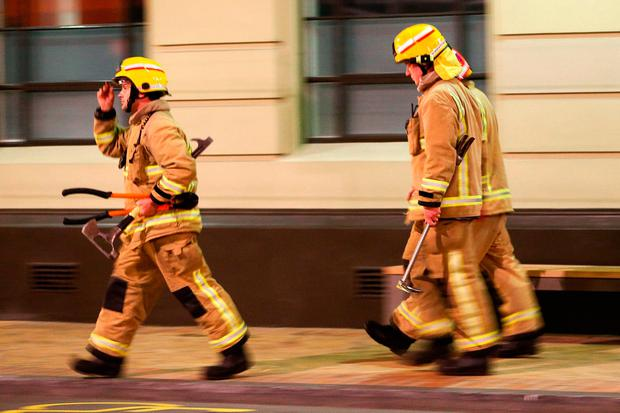 Firefighters attend a callout. (Photo by Hagen Hopkins/Getty Images)