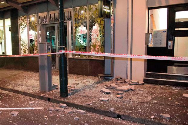Debris from a shop front in the capital. AFP/Getty Images