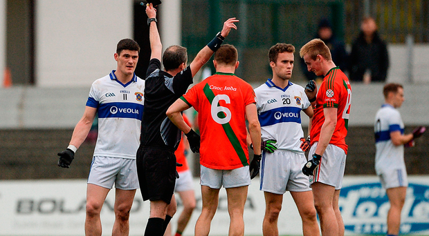 St Vincent's captain Diarmuid Connolly (left) receives a black card from referee Niall Ward during yesterday's Leinster quarter-final. Photo by Daire Brennan/Sportsfile