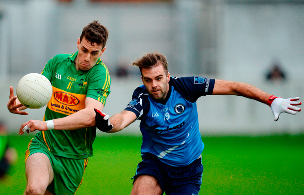 Nial McNamee of Rhode in action against Shane Barry of Simonstown Gaels. Photo by Seb Daly/Sportsfile