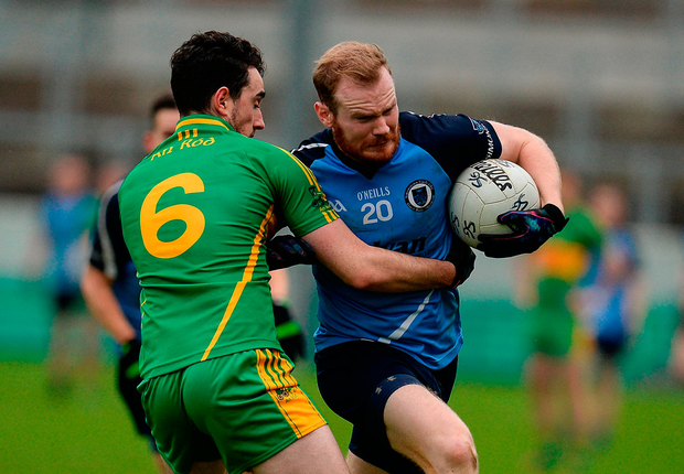 Michael Brennan of Simonstown Gaels in action against Eoin Rigney of Rhode. Photo by Seb Daly/Sportsfile