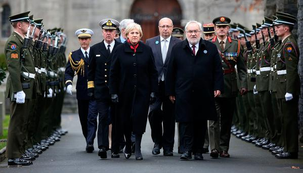 Arts Minister Heather Humphreys and French Veterans Minister Jean-Marc Todeschini (second from right) arrive at the dedication of a Ginchy Cross ceremony in Glasnevin Cemetery, Dublin, yesterday. Photo: Gerry Mooney