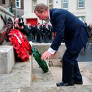 Taoiseach Enda Kenny lays a wreath at the Cenotaph in Enniskillen for Remembrance Sunday. Photo: Niall Carson/PA Wire