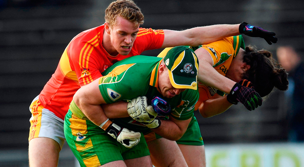 Danny Kirby (left) of Castlebar Mitchels tussles with Corofin's Bernard Power (centre) and Kieran Molloy during yesterday's clash. Photo by Ramsey Cardy/Sportsfile