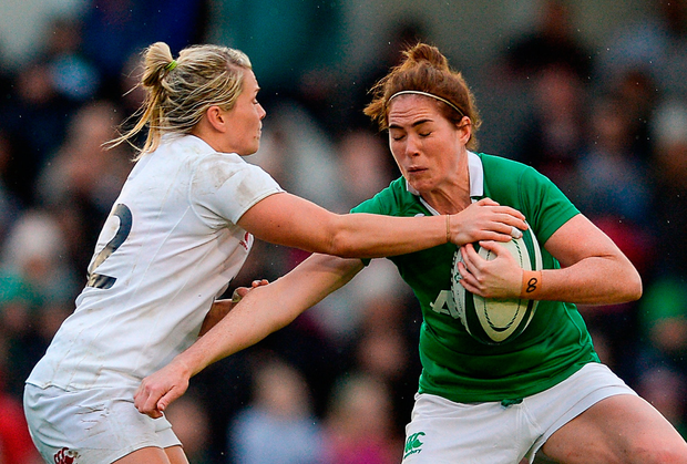 Nora Stapleton of Ireland is tackled by Rachel Burford of England. Photo by Eóin Noonan/Sportsfile