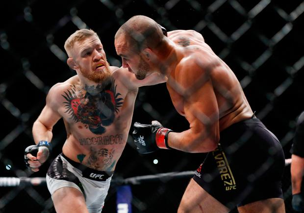 Conor McGregor goes on the attack againts Eddie Alvarez. Photo credit: Adam Hunger-USA TODAY Sports