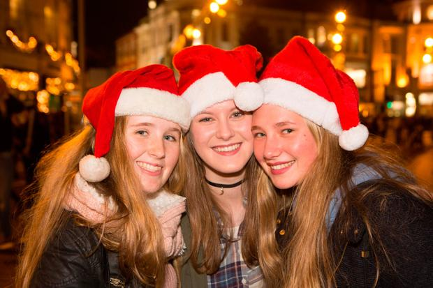 Jessica Murphy, Chiara Casarin and Chiara Bruscagin from Carrigaline, Co Cork, at the switching-on of the Christmas lights. Pic Darragh Kane