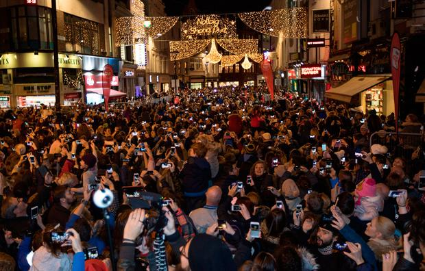 A large crowd watches the ceremony to switch on the Christmas lights on Grafton Street, Dublin. Picture by Fergal Phillips