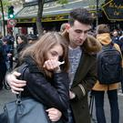 People console each other at a memorial outside the Bataclan concert hall in Paris yesterday (AP Photo/Michel Euler)
