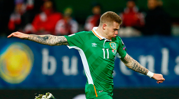 James McClean has eyes only for the ball as he scores against Austria. Photo: Reuters