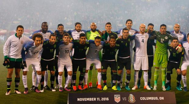 US and Mexico players unite for a team photo ahead of their World Cup qualifier in Colombus Getty