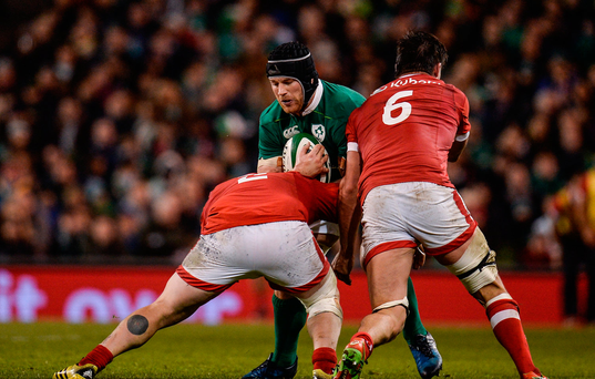 Sean O'Brien of Ireland is tackled by Ray Barkwill, left, and Kyle Baillie of Canada during the Autumn International match between Ireland and Canada at the Aviva Stadium