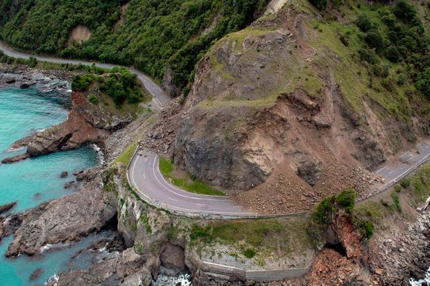 A landslide covers a section of state highway 1 near Kaikoura, New Zealand, Monday, Nov. 14, 2016, after a powerful earthquake.(David Alexander/SNPA via AP)