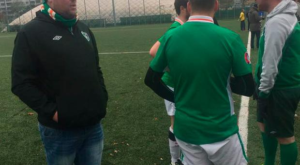 Ireland manager Podge Hayes with the players at half time