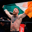 Conor McGregor celebrates after defeating Eddie Alvarez