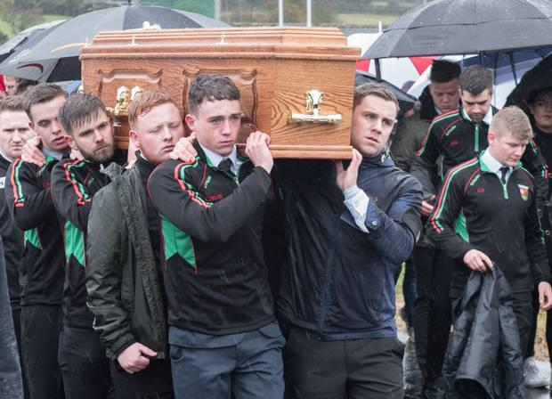 Kevin King's coffin being carried as team-mates from St Mary's