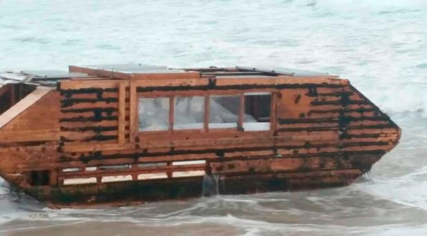 Undated handout photo taken with permission from the Facebook page of Ballyglass Coast Guard Unit of a makeshift solar-powered houseboat that has washed up on an Irish beach after apparently drifting across the Atlantic Ocean from Canada. Photo: Ballyglass Coast Guard Unit/PA Wire