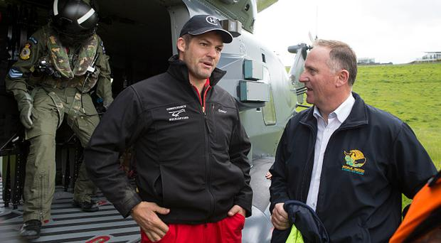 KAIKOURA, NEW ZEALAND - NOVEMBER 14: Prime Minister John Key and former All Black captain Richie McCaw are seen during a visit to Kaikoura on November 14, 2016 in New Zealand. The 7.5 magnitude earthquake struck 20km south-east of Hanmer Springs at 12.02am and triggered tsunami warnings for many coastal areas. (Photo by Mark Mitchell - Pool/Getty Images)