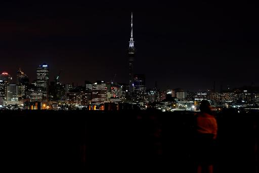 AUCKLAND, NEW ZEALAND - NOVEMBER 14: The Sky Tower is illuminated Black and White as as a sign of solidarity after a 7.5 magnitude earthquake. Photo by Fiona Goodall/Getty Images