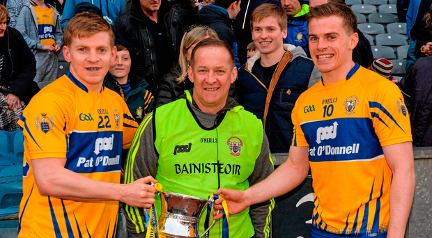 Clare football boss Colm Collins celebrates with sons Podge and Sean (right) after the team's Division 3 NFL final win over Kildare, but Podge has opted to focus on hurling (far left) for 2017. Picture credit: Piaras Ó Mídheach / SPORTSFILE